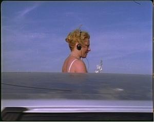 1, 2, 3 Frances behind car